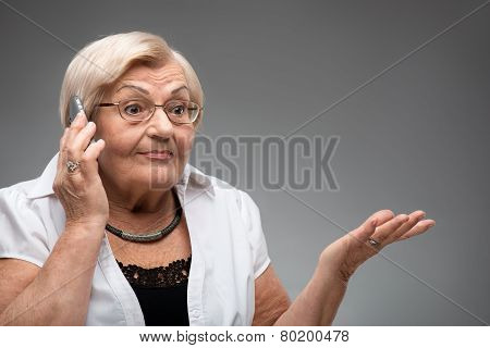 Elderly woman holding smartphone