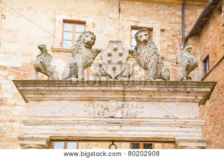 Details of ancient well of griffins and lions, Montepulciano, Tuscany, Italy.