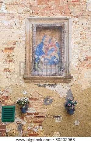 St Mary painting at the wall in Tuscany, Italy