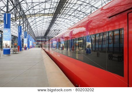 MOSCOW - SEP 24: Aeroexpress red train in Sheremetyevo Airport on September 24, 2014 in Moscow. Sheremetyevo International Airport is one of the three major airports that serve Moscow
