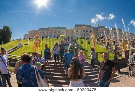 People Walking In Front A Palace Of The Main Buildings At Peterhof Complex