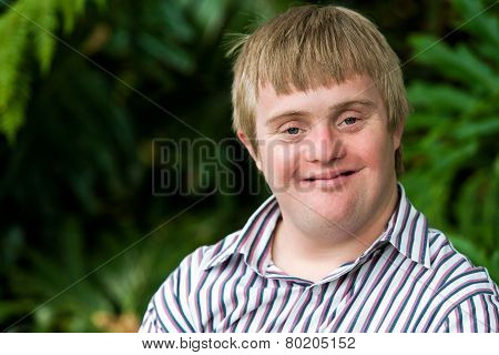 Portrait Of Young Handicapped Man.