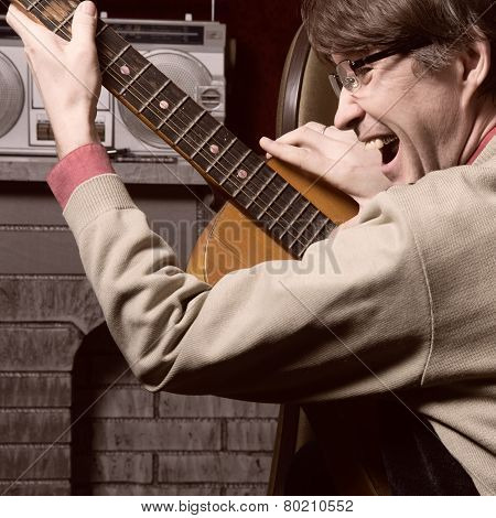 Cheerful Man In Glasses Playing Guitar.
