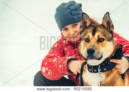 Girl Child and Dog hugging and playing Outdoor