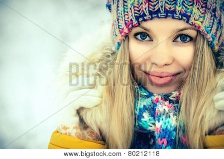 Winter Woman Face portrait happy smiling in knitting hat