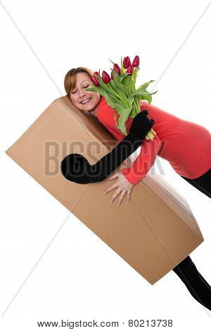 Concept: Package Deliverer With Flowers Is Hugging A Woman