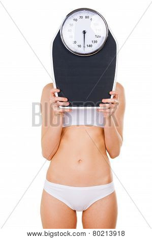 Woman With Weight Scale.