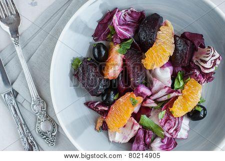 Beet, Orange, Radicchio, Olives Salad. Close-up
