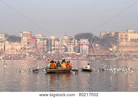 Hindu Pilgrims On Boat In The Ganges River, Varanasi, India
