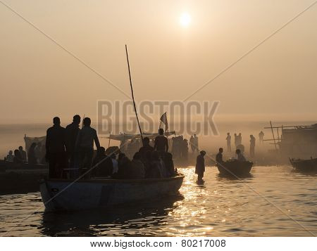 Pilgrims Approaching The East Bank Of The Ganges In Varanasi, India