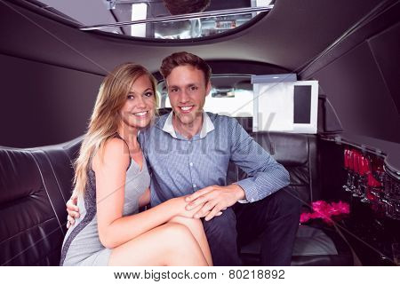 Happy couple smiling in limousine on a night out
