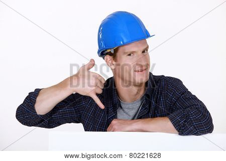 Manual worker making a phone shape