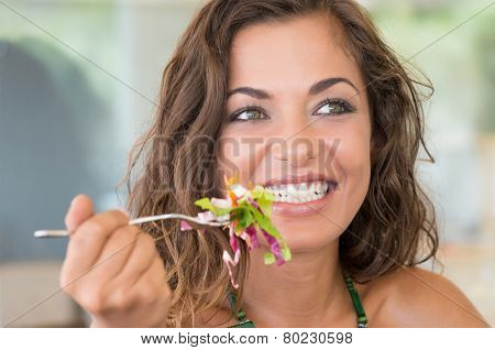 Young Smiling Girl Eating Salad At Luch Break From Work