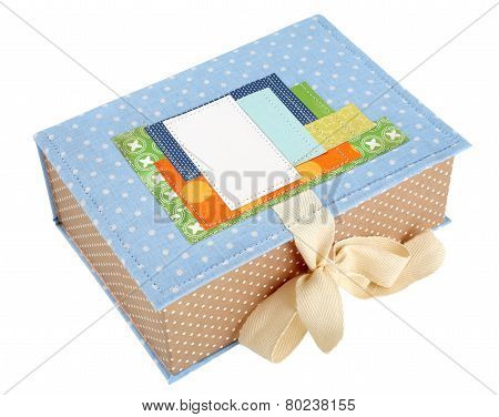 Handmade box tied with a ribbon isolated on a white background.