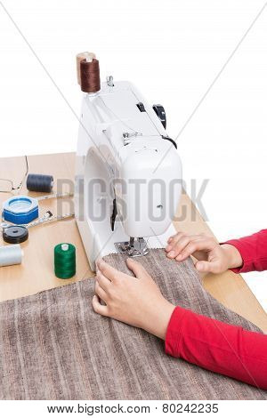 Industrial Sewing Machine And Hand Seamstress. Close-up.