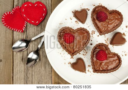 Chocolate Heart Dessert Cups With Pudding And Raspberries