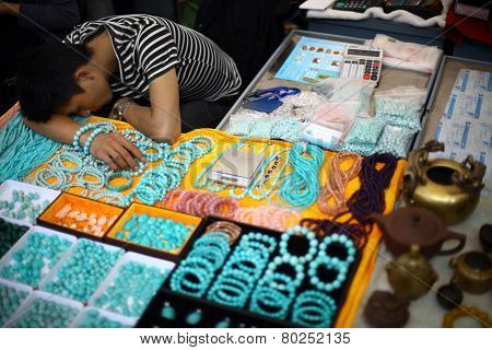 Jewelry Vendor Sleeping