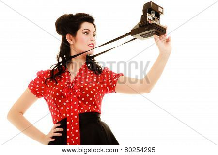 Retro. Pinup Girl Taking Photo With Vintage Camera