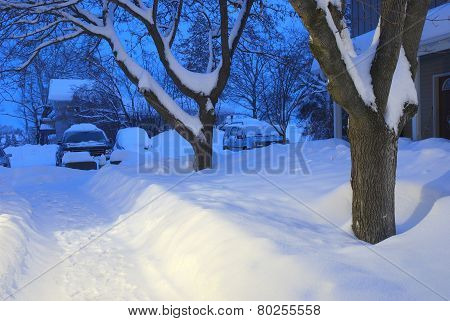 Snow Covered Apartment Courtyard