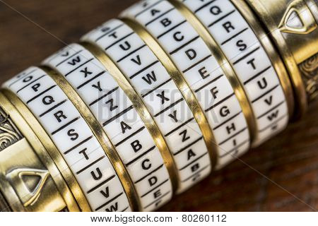 taxes word as a password to combination puzzle box with rings of letters