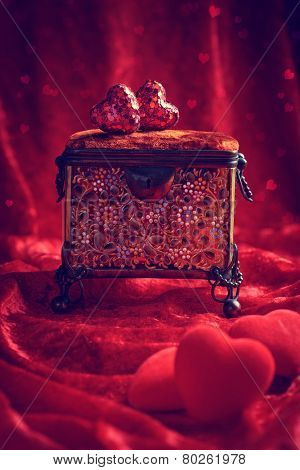 Antique jewellery casket with red hearts for Valentines day