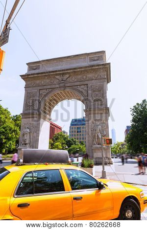 Manhattan Washington Square Park Arch and yellow cab in New York City USA