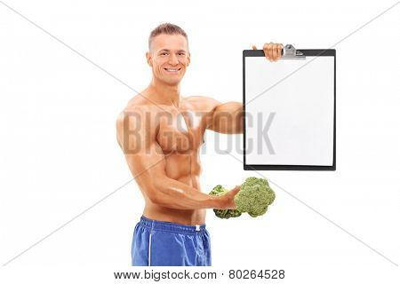 Man holding a broccoli dumbbell and a clipboard isolated on white background