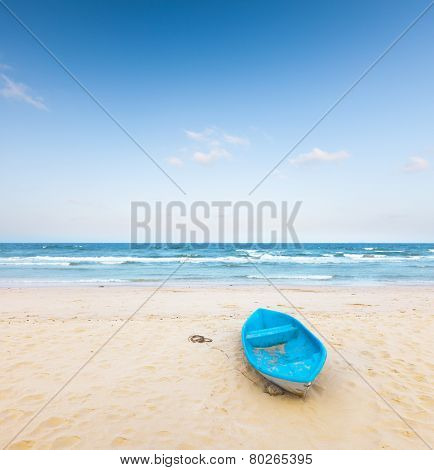 beach and  fishing boat