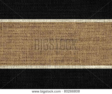 Pastel brown and black burlap jute fabric textured background
