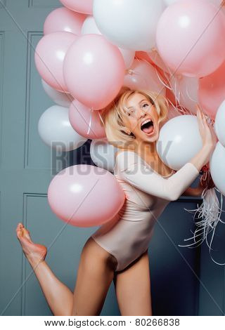 young happy blonde woman with baloons smiling close up