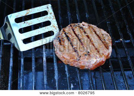 Flipping hamburger