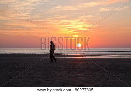 Man Alone On Beach At Sundown In Holland
