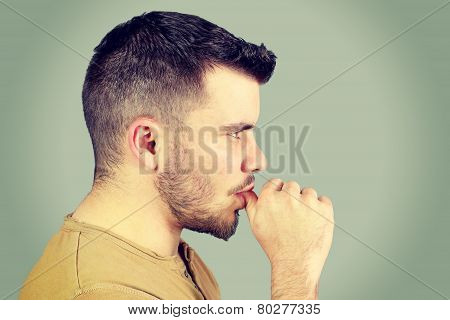 young man who sucks his thumb