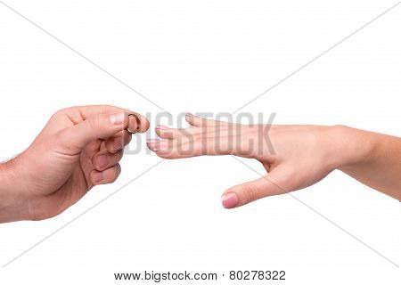 Man putting a wedding ring on her finger