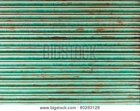 Green and rusty iron curtain texture