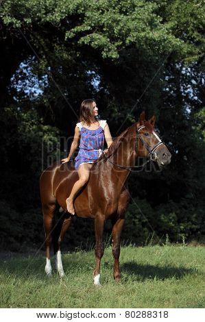 Girl posing on a horse bareback