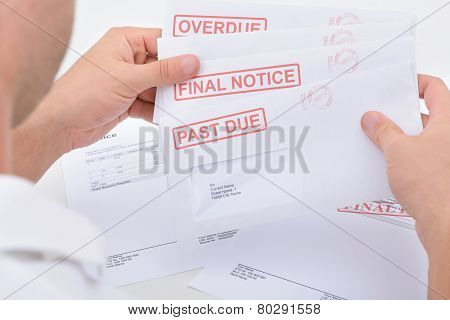 Man Holding Legal Notices