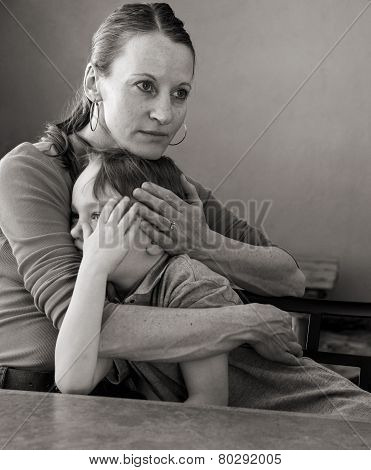 mother comforting crying young son