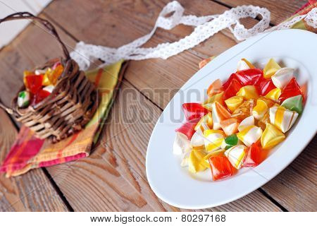 Plate And Basket With Colorful Sweet Candies