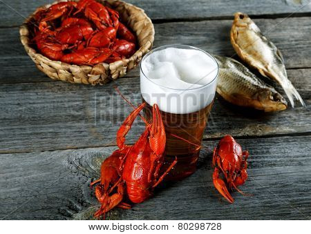Tasty Boiled Crayfishes Fish And Beer On Old Table
