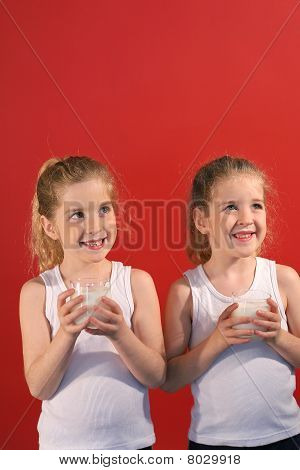 twins drinking milk vertical