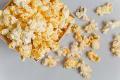 stock photo of popcorn  - Full popcorn in classic popcorn box on grey background - JPG
