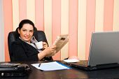 Manager Woman  Holding Coffee And Newspaper