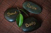 stock photo of soul  - Three black massage stone with words Body - JPG