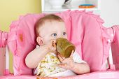 image of mischief  - Baby making a mess in the high chair - JPG