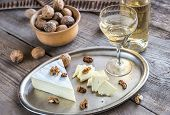 stock photo of brie cheese  - Brie Cheese With Walnuts And Glass Of Wine - JPG