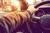 stock photo of steers  - Hand on Wheel Car Driving - JPG