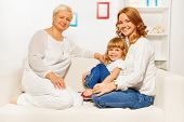 foto of grandmother  - Happy family sitting on the sofa - JPG