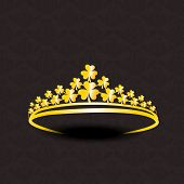 picture of pageant  - Stylish gold crown decorated by shiny golden shamrock leaves on seamless dark brown background - JPG