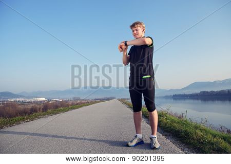 Before Jogging. Young Man Sterted His Watch